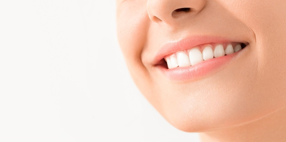 Know How Teeth Whitening Treatment Benefits Your Oral Health